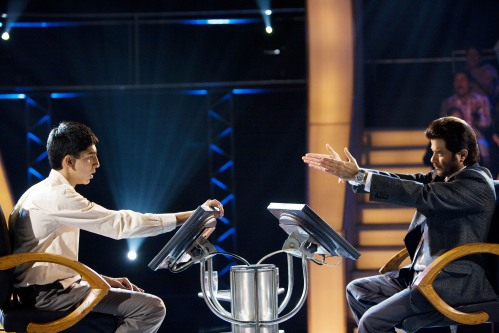 "Dev Patel, left, does his best to field questions from Anil Kapoor in ""Slumdog Millionaire,"" the 2008 winner of Oscar's best picture award."