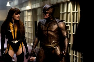 "Malin Akerman, left, and Patrick Wilson play superheroes in ""Watchmen."""