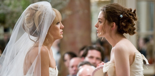 "Kate Hudson, left, and Anne Hathaway face off in the comedy ""Bride Wars."""