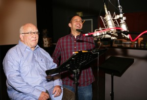 "Actor Ed Asner, left, and producer Jonas Rivera work on the vocal track for ""Up."""