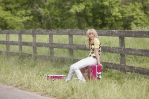 "Miley Stewart (Miley Cyrus) contemplates country life in ""Hannah Montana: The Movie."""