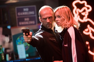 "Chev Chelios (Jason Statham) and his girlfriend, Eve (Amy Smart), get down and dirty in the action film ""Crank 2: High Voltage."""