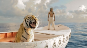 "Pi Patel (Suraj Sharma) and a fierce Bengal tiger named Richard Parker are forced to share a lifeboat in director Ang Lee's ""Life of Pi."""