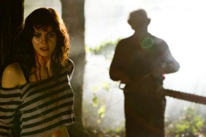 "Alexandra Daddario, left, plays Heather Miller and Dan Yeager plays Leatherface in the horror-thriller ""Texas Chainsaw."""