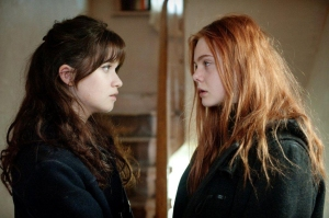 "Alice Englert, left, and Elle Fanning star in the drama ""Ginger & Rosa."""