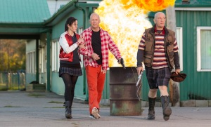 "From left to right, Mary-Louise Parker, Bruce Willis and John Malkovich star in the action-comedy ""RED 2."""