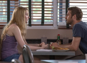 "Evan Rachel Wood, left, and Scott Speedman star in the offbeat romance ""Barefoot."""