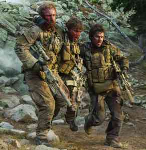 "From left to right, Ben Foster, Emile Hirsch and Mark Wahlberg play US Navy SEALs in ""Lone Survivor."""