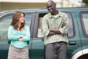 "Reese Witherspoon, left, and Ger Duany star in ""The Good Lie,"" a drama inspired by the real-life story of the Lost Boys of Sudan.  Photo courtesy of Warner Brothers"